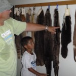 Steve and Jesse looking at pelts.