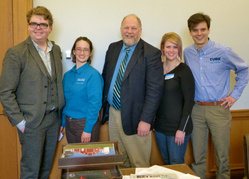 Staff and members with Senator Lyle Koenan.