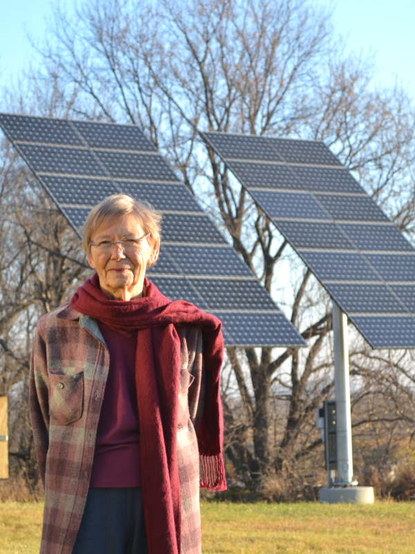 Virginia Homme with her home-scale solar installation.