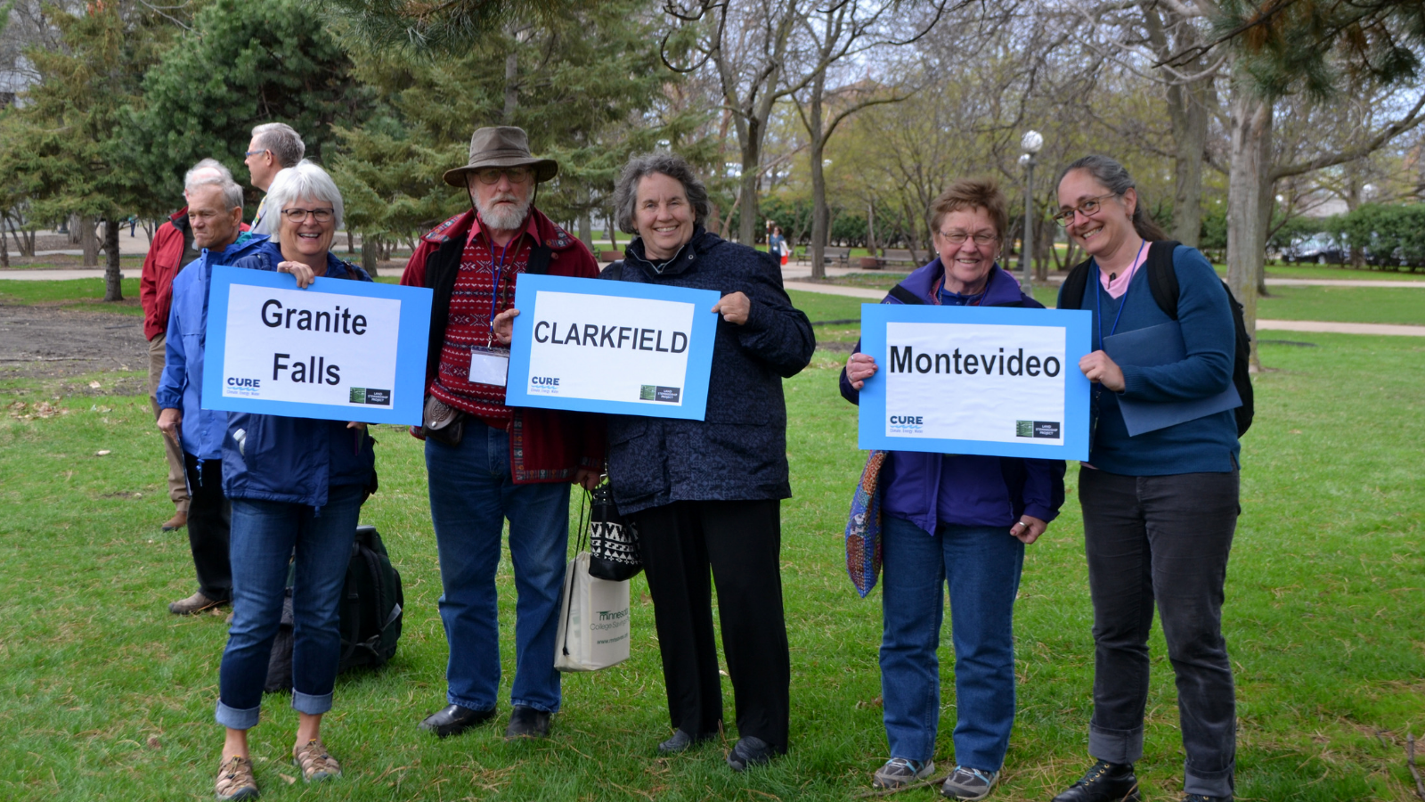 CURE members with signs of their towns at Water Action Day.