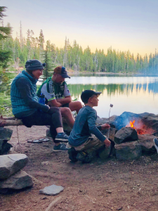family camping at a lake