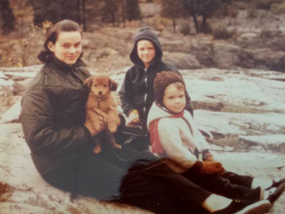 Dixie camping with her kids and dog.
